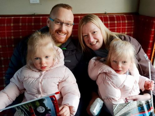 Jamie Buchanan with wife Kathryn and their twin daughters.