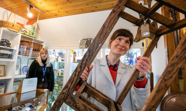 Staff member Caitlin Ritchie and antiques expert Natasha Raskin Sharp.