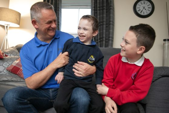 Four-year-old Fife youngster Cameron Gilmour with dad, Jim and brother, Scott,11.
