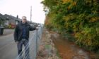 Mark Watters outside his home which was one of several devastated by flood water.