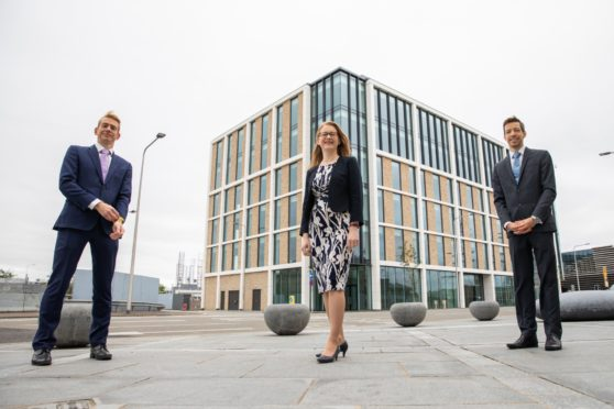 Cabinet Secretary for Social Security, Shirley-Anne Somerville (centre)  Dundee City Council leader John Alexander (right) and Chief Executive of Social Security Scotland, David Wallace, at the new headquarters.