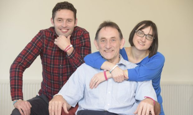 Jo Williamson with twins James and Jennie who have both inherited the rare cancer.