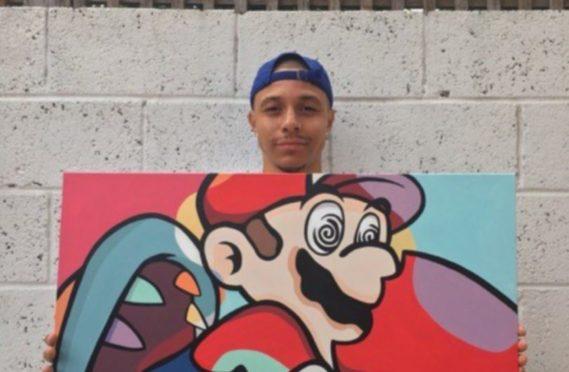 Leighton McIntosh alongside his artwork.