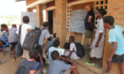 Beath High School teacher Ian Mitchell involved in lessons on plant fertilisation at Njale and Sanitation at Mapanga.