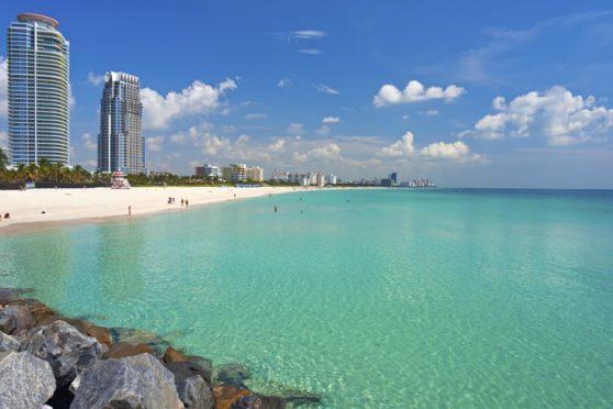Saints trio met on beach in Miami last year.