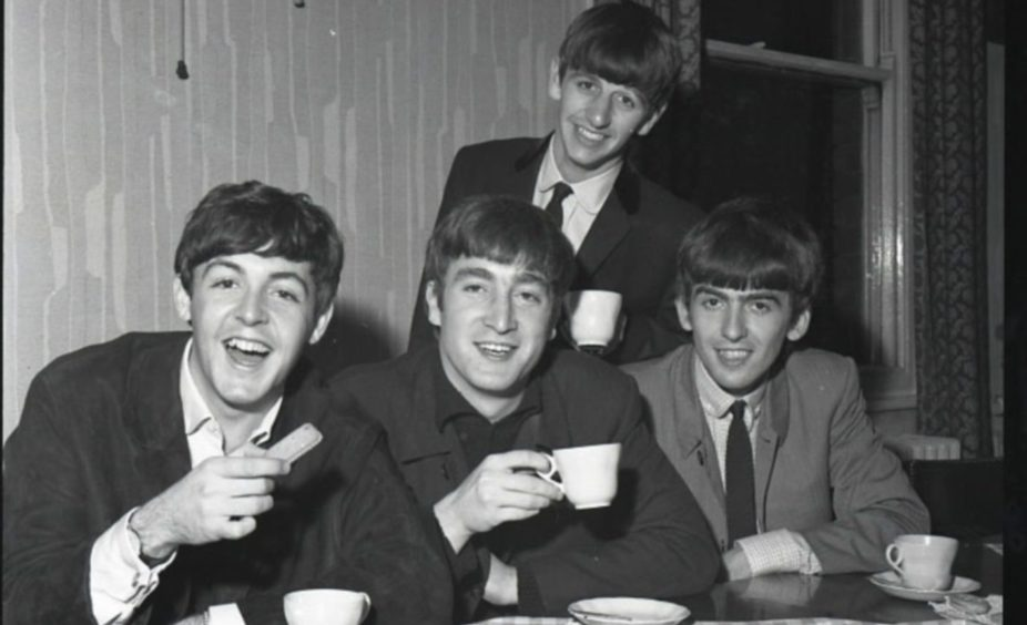 The Beatles backstage at the Caird Hall on October 7 1963 - enjoying a cup of tea.
