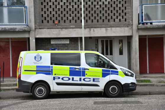 A police van outside the flats on Wednesday morning.