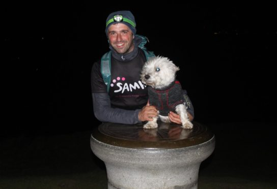 Ross and his pet dog, Dex, at the top of the final climb of East Lomond Hill at 1am.
