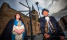 Lynne Knight (of History and Horror Tours) alongside Dave McNamara (a new member of the History and Horror Tours group) -- near St John's Kirk, St John's Place, Perth.
