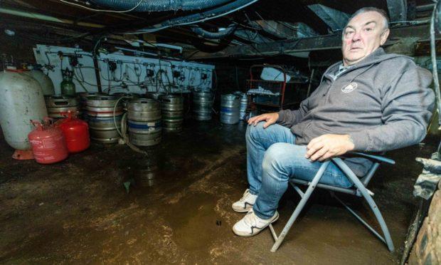 Willie Keenan in his damaged cellar.