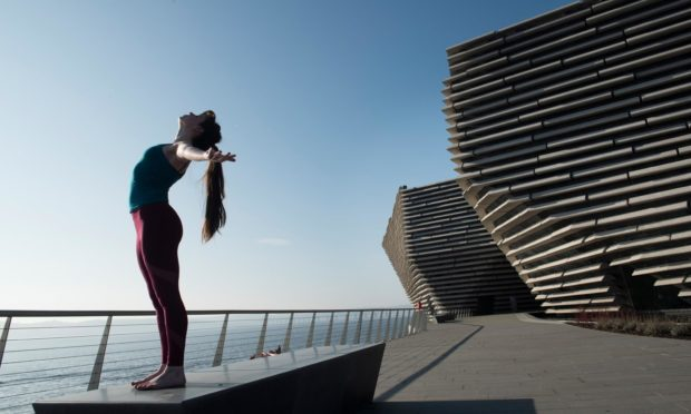 A dancer outside V&A Dundee.