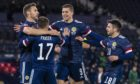 The Scots celebrate Ryan Fraser's early goal.