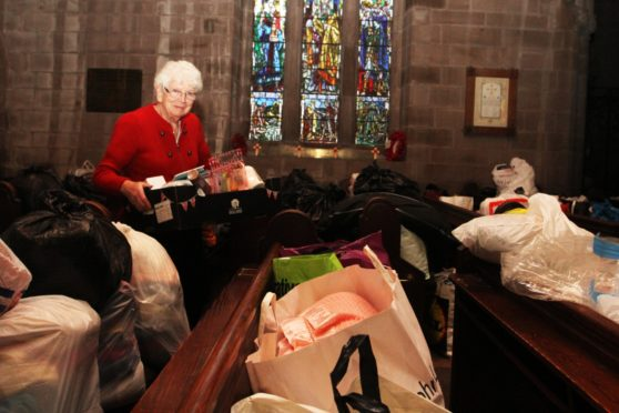 Irene Gillies with items donated during a previous Syria Aid appeal.