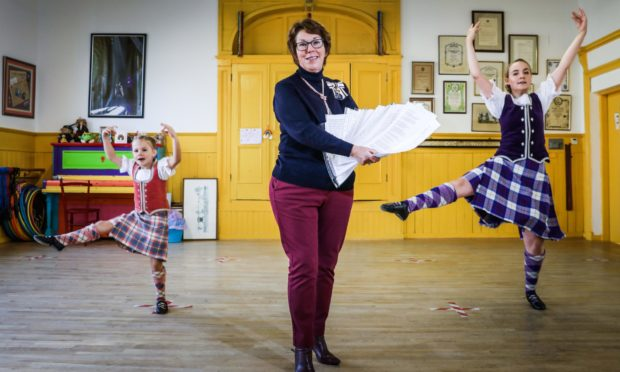 Highland Dancers Harla Masson, 6, and Rowan Walker, 17, with Angus Lord Lieutenant Pat Sawers.