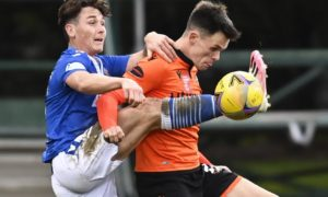 Dundee United's Lawrence Shankland fights for the ball with St Johnstone's Danny McNamara.