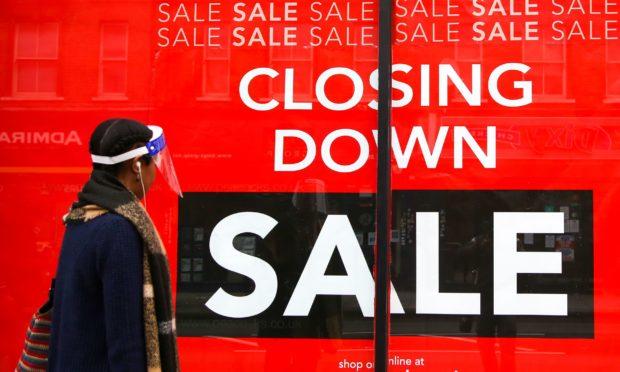 A closing down sign at a Peacocks store