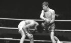 British boxer Ken Buchanan, left, fights against Mexican boxer Ruben Navarro during their championship fight at the Los Angeles Memorial Sports Arena.