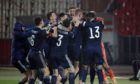 Scotland stars celebrate famous win over Serbia.