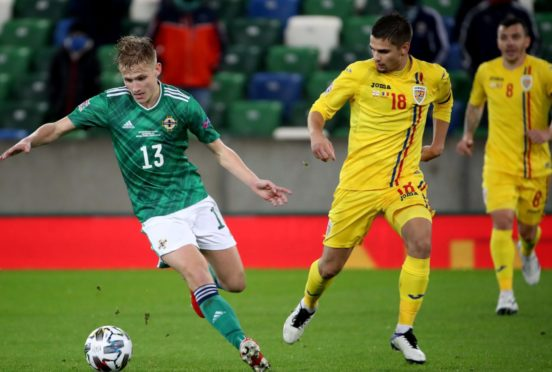 Ali McCann in action against Romania.