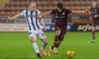 Dunfermline midfielder Kerr McInroy hassles Hearts' Olly Lee.