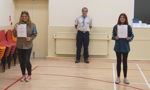 Explorer Scout Alicia Thomson (left) with Scout Maddison MacPherson (right) with District Commissioner for Kirkcaldy Scouts District Richard Cook
