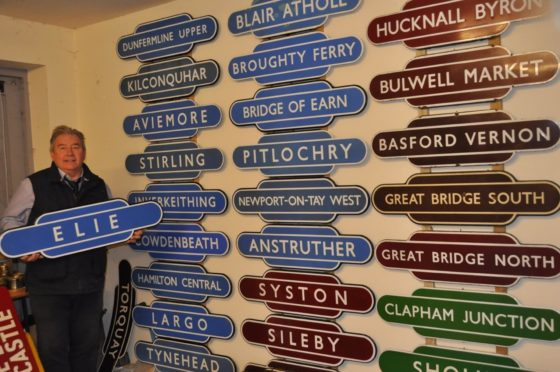 Auctioneer Neil Booth is pictured with some of the signs.