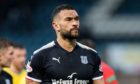 Steven Caulker in action for Dundee.