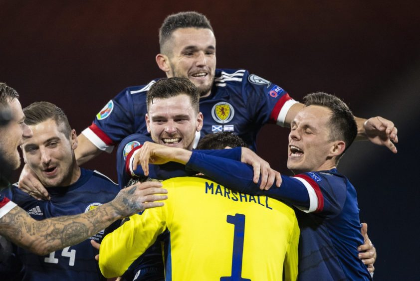 Scotland's players react to Kenny McLean's winning penalty against Israel at Hampden.