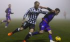 Richard Tait and Dundee United left-back Jamie Robson chase down the ball at a foggy St Mirren Park.