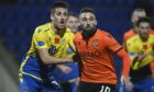St Johnstone defender Callum Booth keeps a close eye on Tangerines hitman Nicky Clark.