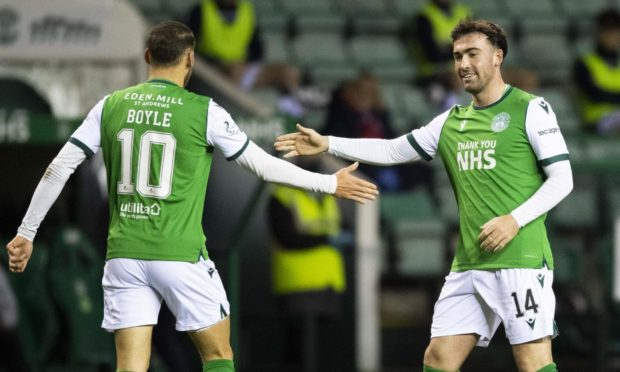 Hibernian's Stevie Mallan celebrates his opening goal against Dundee at Easter Road.
