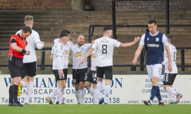 Ayr United players celebrate Michael Moffat's goal after going 2-0 up against Dundee.