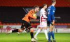 Nicky Clark collects the ball after his equaliser.