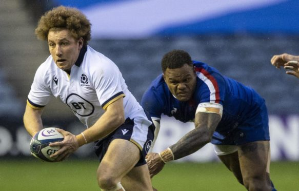 Duncan Weir drives forward away  from France's Virimi Vakatawa.