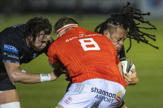 Glasgow Warriors' Ryan Wilson and TJ Ioane (right) try to stop Muster's Gavin Coombes.