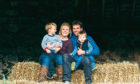 Eilidh in the steading with her husband Craig and their sons Jack, three, and Andrew, one.