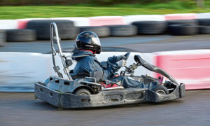 Gayle whizzes round the track at Lochter in a go kart.