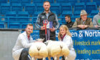 WINNERS: Beltex crosses from Rory Gregor, left, won last year's prime lambs show.