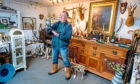 John Lacey, one of a handful of horn/antler carvers in Scotland, at his shop in Lawers, Perthshire.