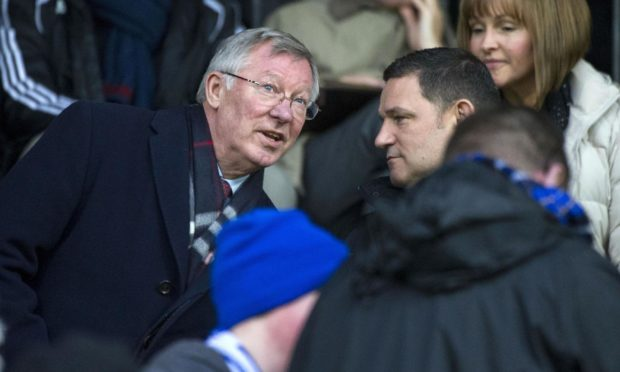Sir Alex Ferguson chats to St Johnstone chairman Steve Brown in the McDiarmid Park directors' box..