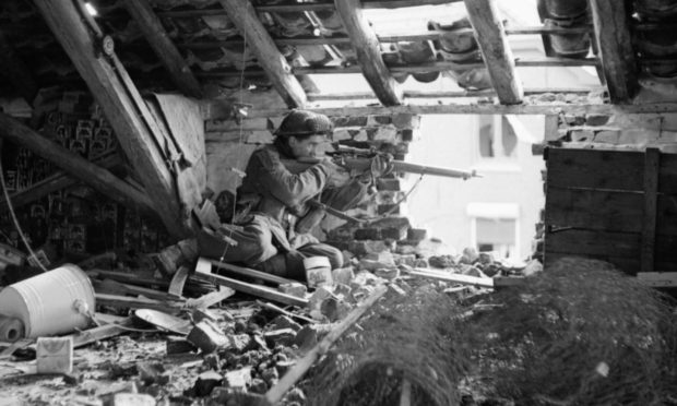 A Black Watch sniper in Holland during a battle.