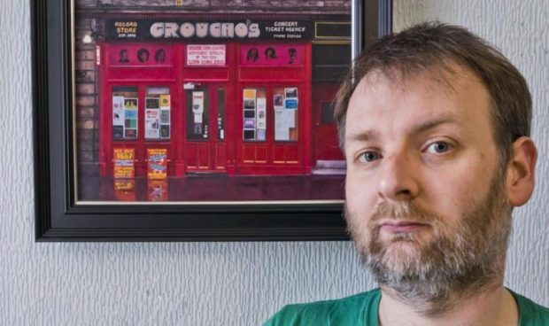 Alex Dewars with his painting of the iconic Dundee record store.