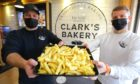 Clark's Bakery owner Jonathon Clark with operations manager Daniel Bunce and lots and lots of chips.