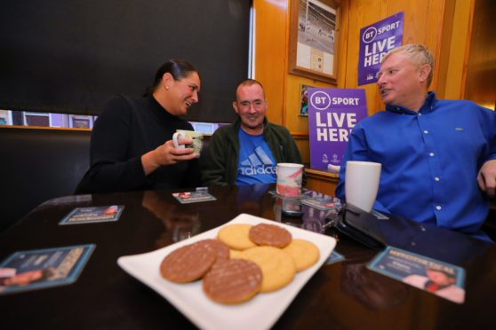 Lyn Mcgrattan (left) and Derrick Murdoch with customer Bruce Fitchet at Dexy's.
