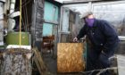 Martin Leiper, beside a damaged door, at one of the plots at the Old Craigie Road allotments in Dundee