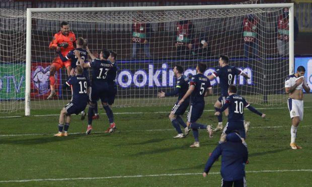 Scotland's players celebrate David Marshall's Belgrade heroics.