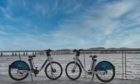 Two of the e-bikes at Dundee's waterfront.