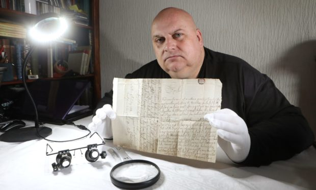 Author Lenny Low from Leven with the manuscript