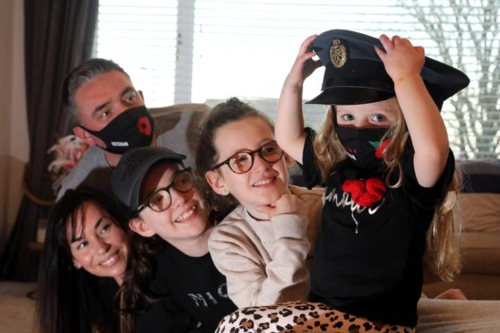 Forfar designer Kylie Long has created facemasks for remembrance day , with her partner David McDowall who served in the RAF , pictured stepdaughters Darcy (10) and Amelia (14) and daughter Thea (3)