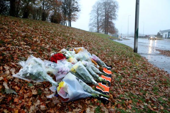 Flowers laid across from Lidl on McAlpine road Dundee where Mr Swan died.